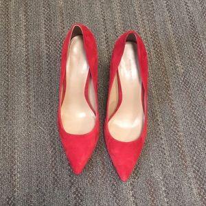 Red suede pumps